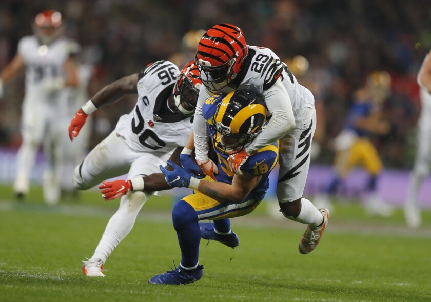 Rams wide receiver Cooper Kupp is tackled by Bengals cornerback Tony McRae during the second half.