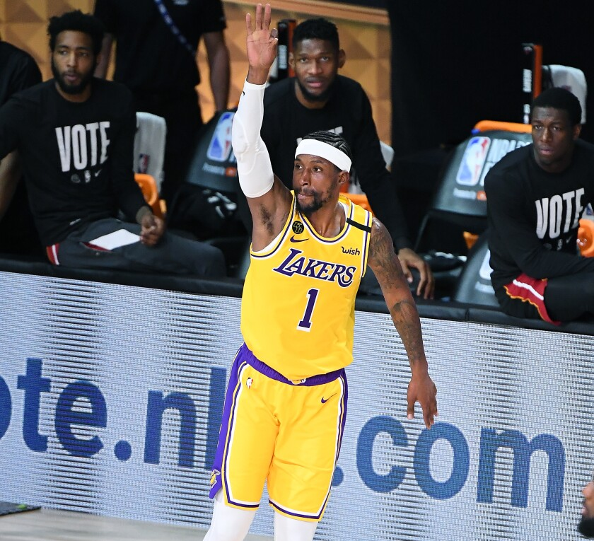 Lakers forward Kentavious Caldwell-Pope celebrates after sinking a three-pointer.