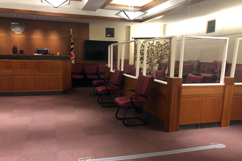 The jury sitting area, right, is spaced out and lined with plastic barriers to protect them from COVID-19 in a courtroom in Annapolis, Md., Thursday, Apri 22, 2021. A jury will decide whether Jarrod Ramos is criminally responsible for killing five people at the Capital Gazette newspaper. Lawyers held a pretrial hearing in the case Thursday. (AP Photo/Brian Witte)