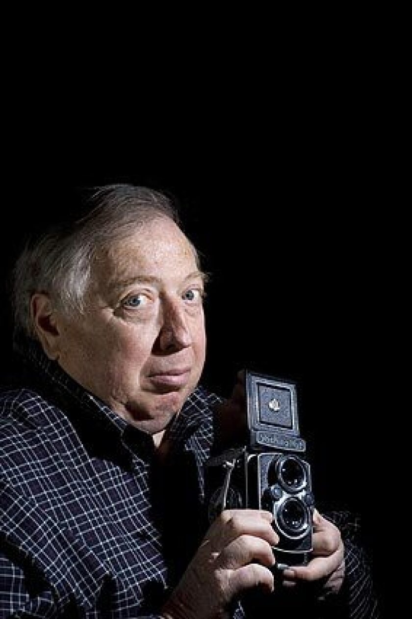 """Neil Leifer holds a Yashica Mat camera that his brother gave him for what Neil thinks was his 60th birthday at his apartment/office space in New York on Dec. 4. He shot a photo of Alan Ameche scoring the winning touchdown in what has often been referred to as """"the greatest game ever played"""" with almost the same camera. It was the sudden-death game between the Baltimore Colts and the New York Giants, which took place on his 16th birthday, Dec. 28, 1958. He later sold the camera, but he said he wishes he still had it."""