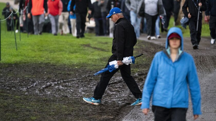 PACIFIC PALISADES, CA - FEBRUARY 14, 2019: Pathways are muddy after more than a 6 hour rain delay du