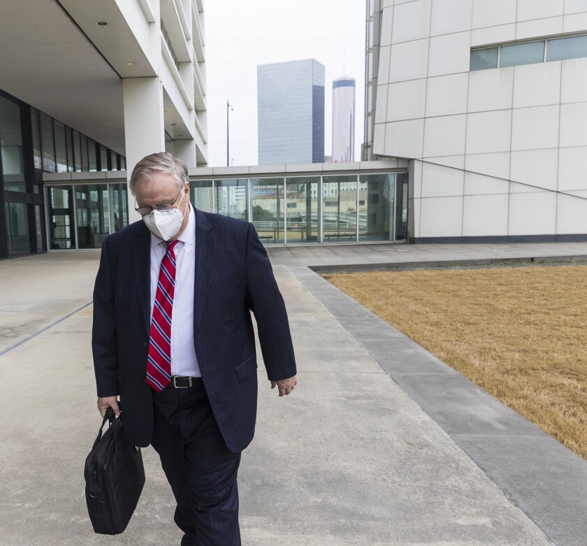 Former Georgia Insurance Commissioner Jim Beck leaves the Richard B. Russell Federal Courthouse after his sentencing on Tuesday, Oct 12, 2021, in Atlanta, Ga. A federal judge has sentenced Beck to more than seven years in prison for fraud. The judge on Tuesday also ordered Beck to pay $2.6 million in restitution to make up for money he stole from an insurer. (Jenni Girtman/Atlanta Journal-Constitution via AP)
