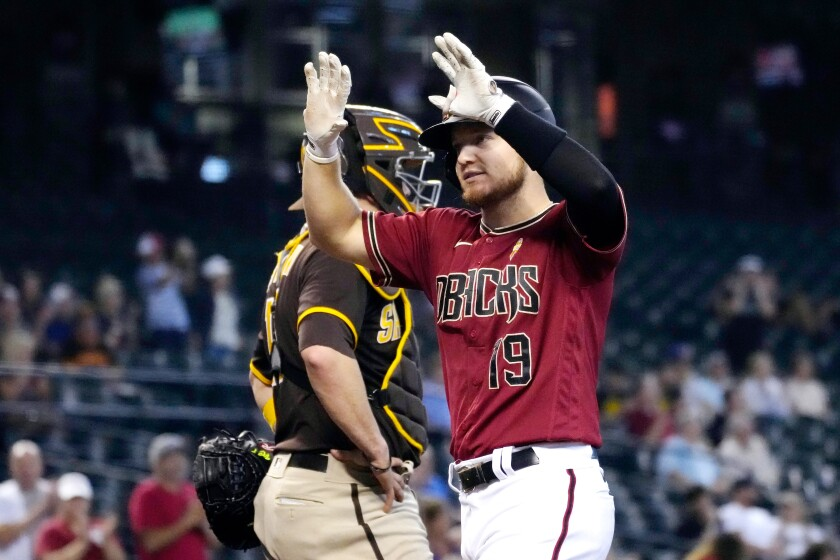 Arizona Diamondbacks' Josh VanMeter (19) reacts after hitting a two-run home run against the San Diego Padres in the third inning during a baseball game, Wednesday, Sept. 1, 2021, in Phoenix. (AP Photo/Rick Scuteri)