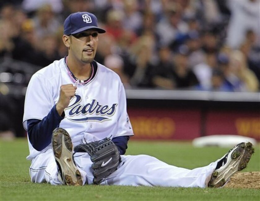 San Diego Padres pitcher Mike Adams pumps his fist after making the play at first base on a ground ball hit by the Los Angeles Dodgers' Matt Kemp during the eighth inning of a baseball game Monday, Sept. 6, 2010 in San Diego. (AP Photo/Denis Poroy)