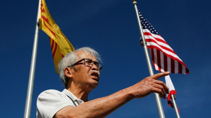 Steve Tran, 80, of Garden Grove, is a mechanical engineer who left Vietnam in 1975 with his wife and children. He supports President Trump's travel ban policy, along with his son. His 14-year-old grandson does not.