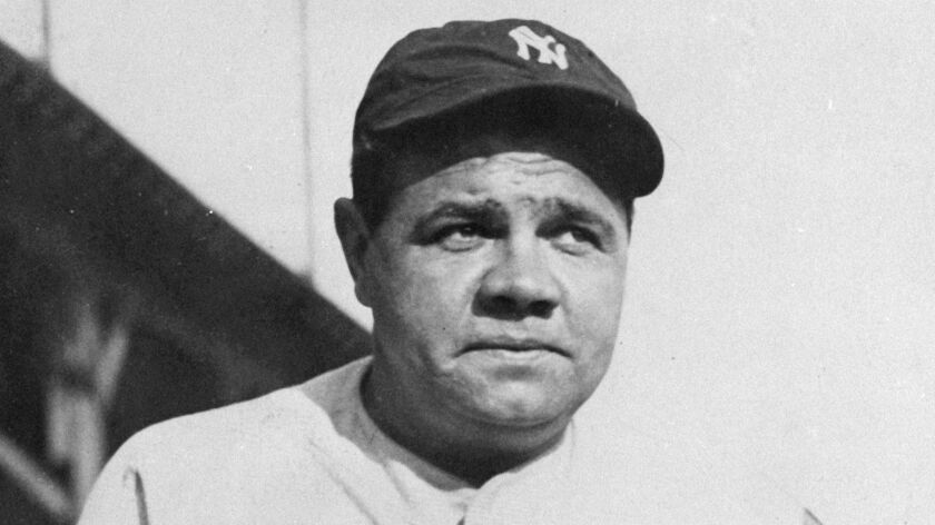 Babe Ruth poses for a photo as a member of the New York Yankees.