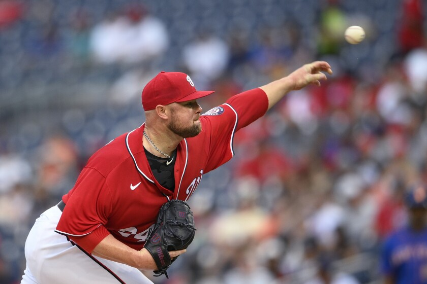 Washington Nationals starter Jon Lester delivers a pitch during the fourth inning of the second baseball game of the team's doubleheader against the New York Mets, Saturday, June 19, 2021, in Washington. (AP Photo/Nick Wass)