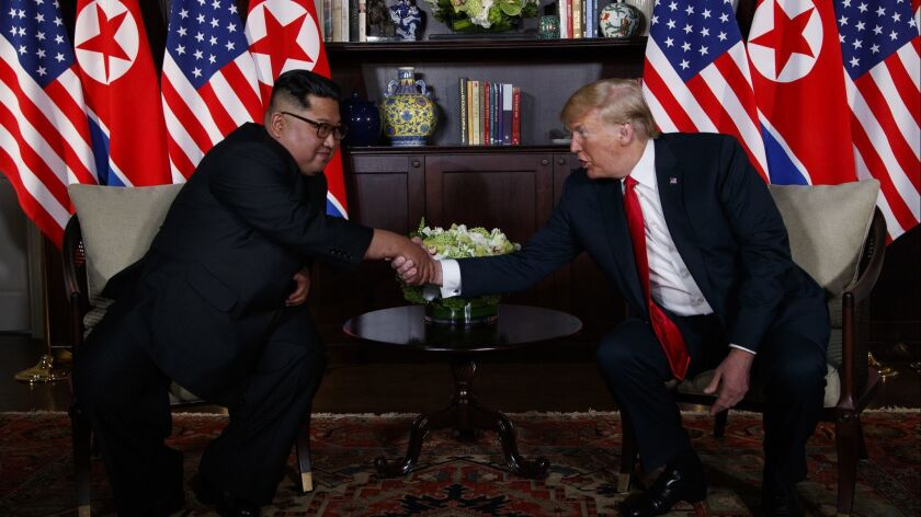 President Donald Trump meets with North Korean leader Kim Jong Un on June 12, in Singapore.