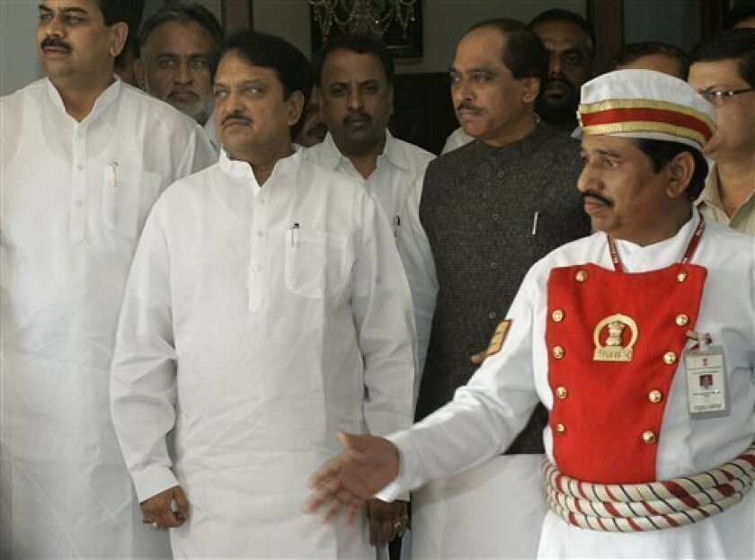 Maharashtra state Chief Minister Vilasrao Deshmukh, second left, leaves the Governor�s office after submitting his resignation in Mumbai, India, Thursday, Dec. 4, 2008. India suspects that two senior leaders of a banned Pakistani militant group masterminded last week's three-day terrorist attacks, an Indian intelligence official said Thursday. (AP Photo/Rajanish Kakade)