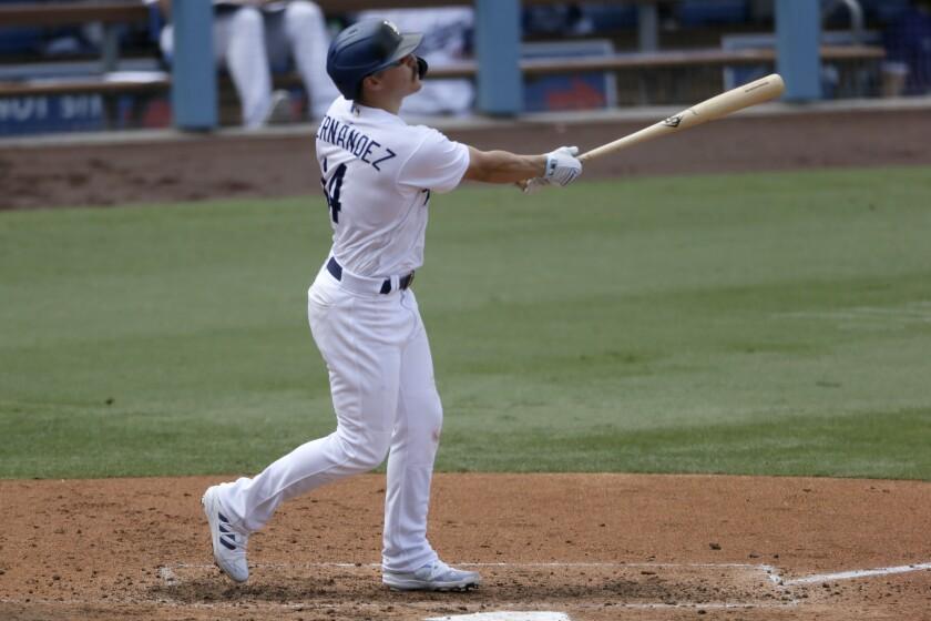 The Dodgers' Kiké Hernández follows through on a three-run home run.