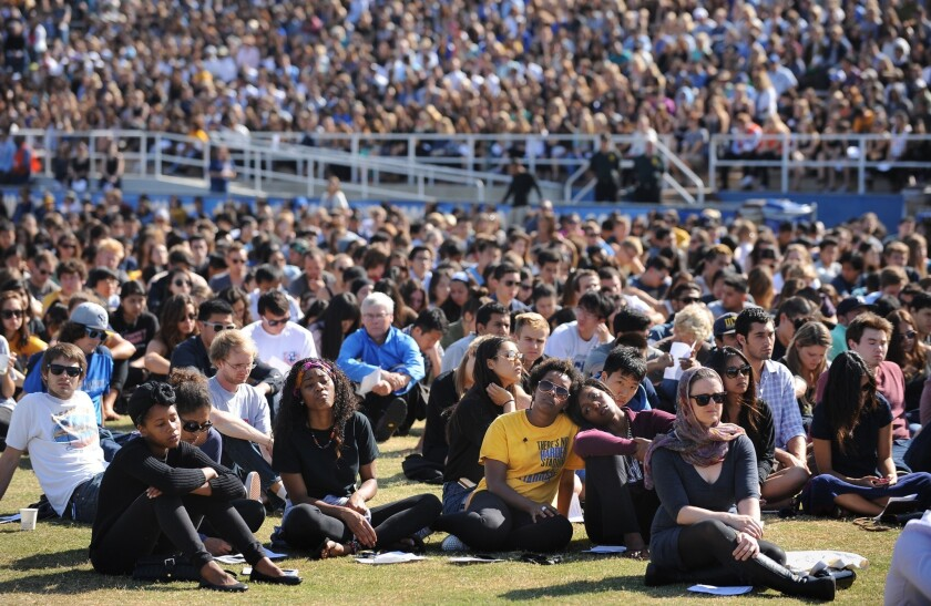Students listen to a memorial service at UCSB for six students slain Friday in Isla Vista.
