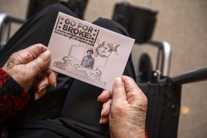 Closeup of a card being held by a person in a wheelchair.