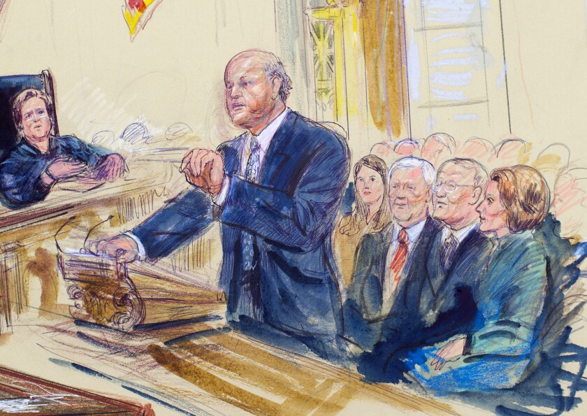A courtroom artist's rendering shows Michael A. Carvin, lead attorney for the petitioners, speaking Wednesday before the Supreme Court in Washington. Justice Elena Kagan is shown at left, and sitting behind Carvin from left to right are Health and Human Services Secretary Sylvia Burwell, Sen. Orrin Hatch (R-Utah) Sen. Lamar Alexander (R-Tenn.) and House Minority Leader Nancy Pelosi (D-San Francisco).