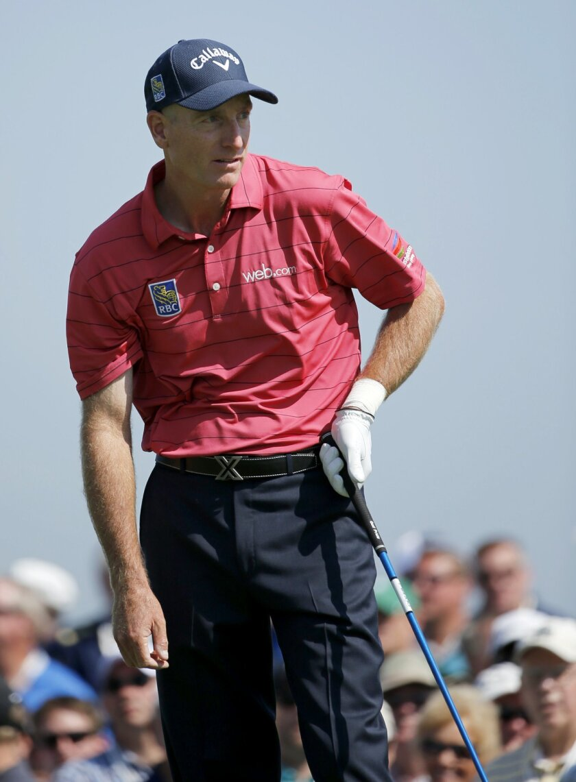 Jim Furyk watches his drive on the 10th tee during the first round of the BMW Championship golf tournament at Conway Farms Golf Club, Thursday, Sept. 17, 2015, in Lake Forest, Ill. Furyk withdrew from the tournament citing a left wrist injury. (AP Photo/Charles Rex Arbogast)