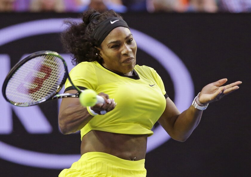 Serena Williams of the United States hits a forehand return to Daria Kasatkina of Russia during their third round match at the Australian Open tennis championships in Melbourne, Australia, Friday, Jan. 22, 2016.(AP Photo/Aaron Favila)