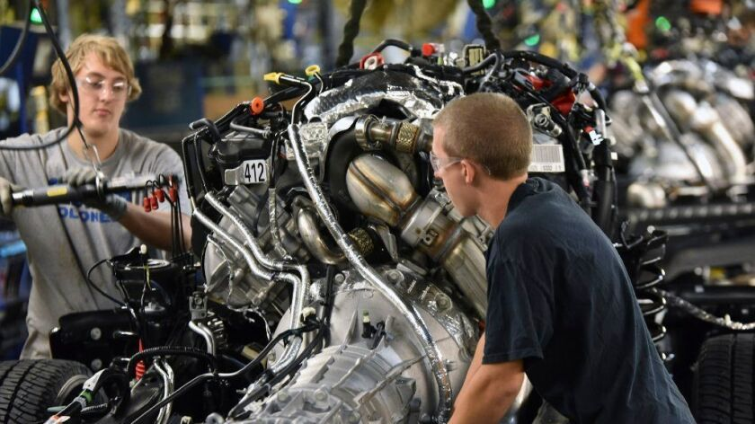 Production workers assemble a 2017 Ford F-Series truck at a plant in Louisville, Ky.