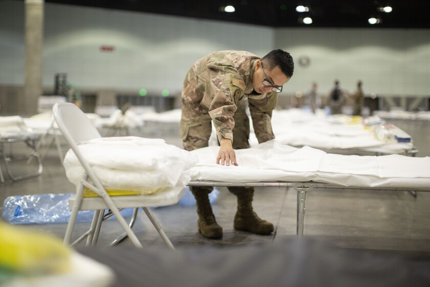 U.S. Air Force Tech. Sgt. Mario Lopez-Casa sets up a federal medical station inside the L.A. Convention Center