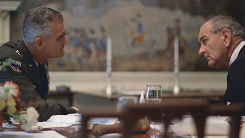 "Gen. William Westmoreland confers with President Lyndon B. Johnson in April 1968, as seen in ""The Vi"