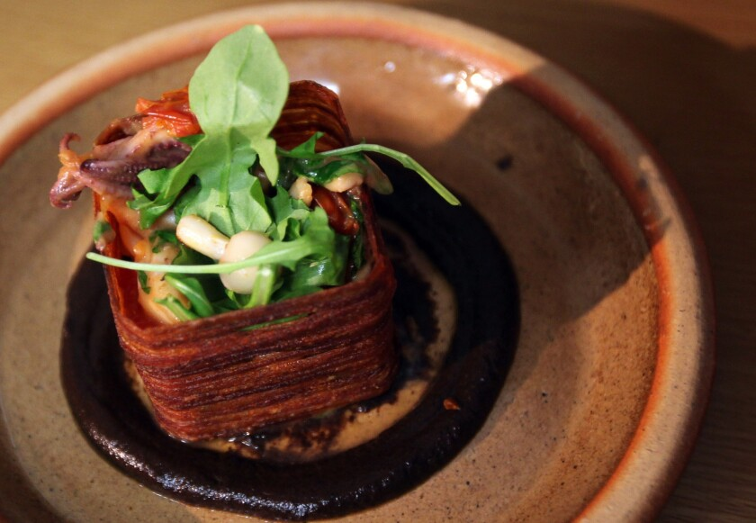 One of Scratch Bar's signature presentations is its Squid in a Box. The box is fashioned from fried potato, and the construction rests on a tar-black purée of charred eggplant.