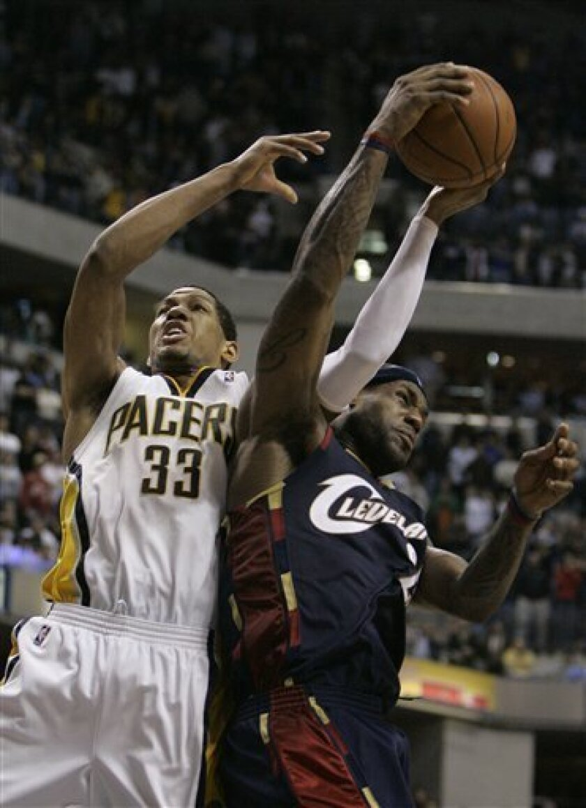 Indiana Pacers forward Danny Granger (33) is fouled by Cleveland Cavaliers forward LeBron James near the end of of an NBA basketball game in Indianapolis, Tuesday, Feb. 10, 2009. Granger hit one free throw to help Indiana win, 96-95. (AP Photo/Darron Cummings)
