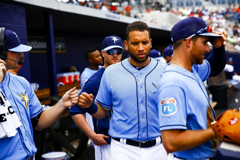 James Loney (21) gets a fist bump from starting pitcher Drew Smyly (33) during a spring exhibition baseball game against the Boston Red Sox, Wednesday, March 30, 2016 in Port Charlotte, Fla.