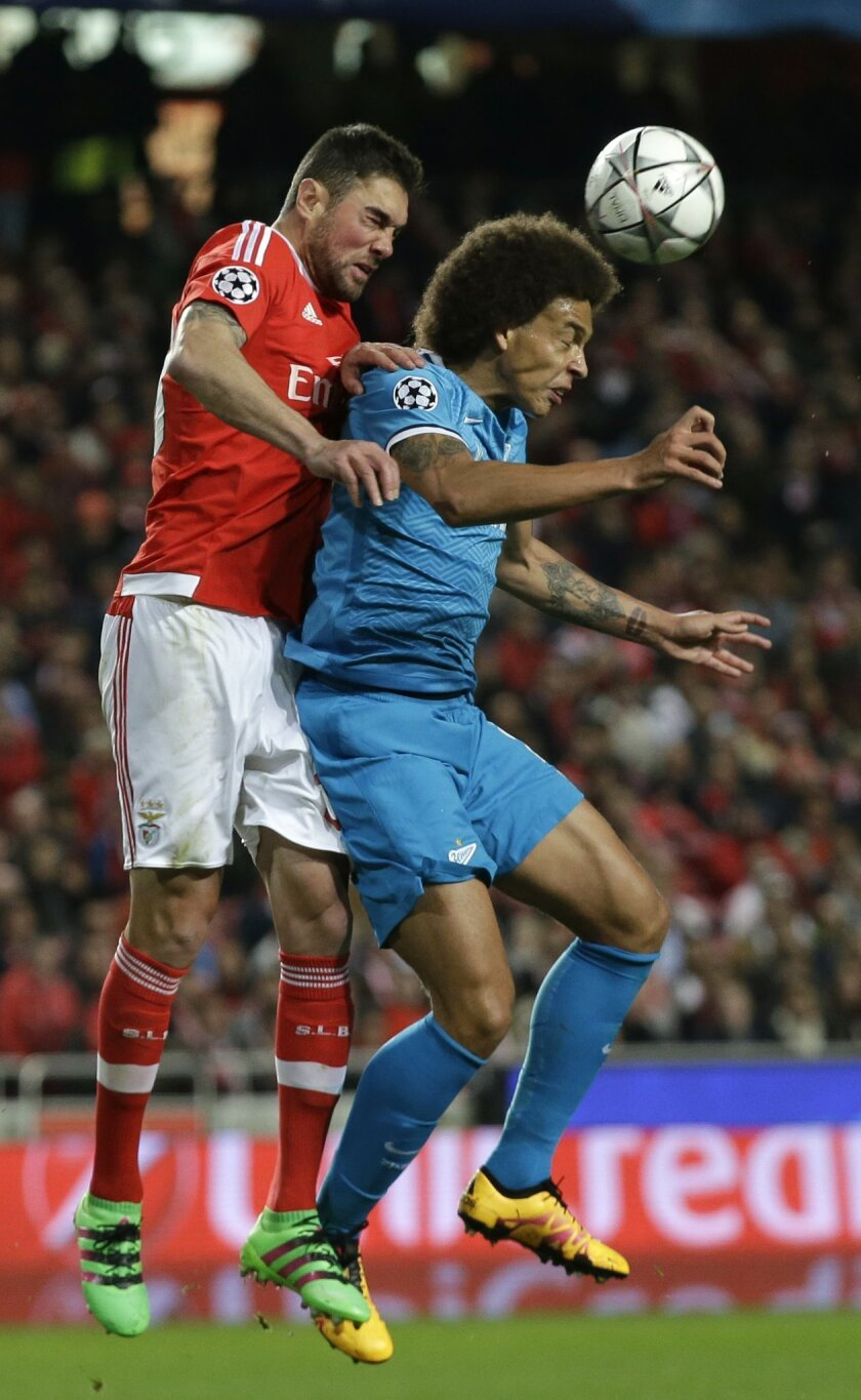 Benfica's Jardel jumps for the ball with Zenit's Axel Witsel during a Champions League Round of 16 first leg soccer match between Benfica and Zenit at Benfica's Luz stadium in Lisbon, Portugal, Tuesday, Feb. 16, 2016. (AP Photo/Armando Franca)
