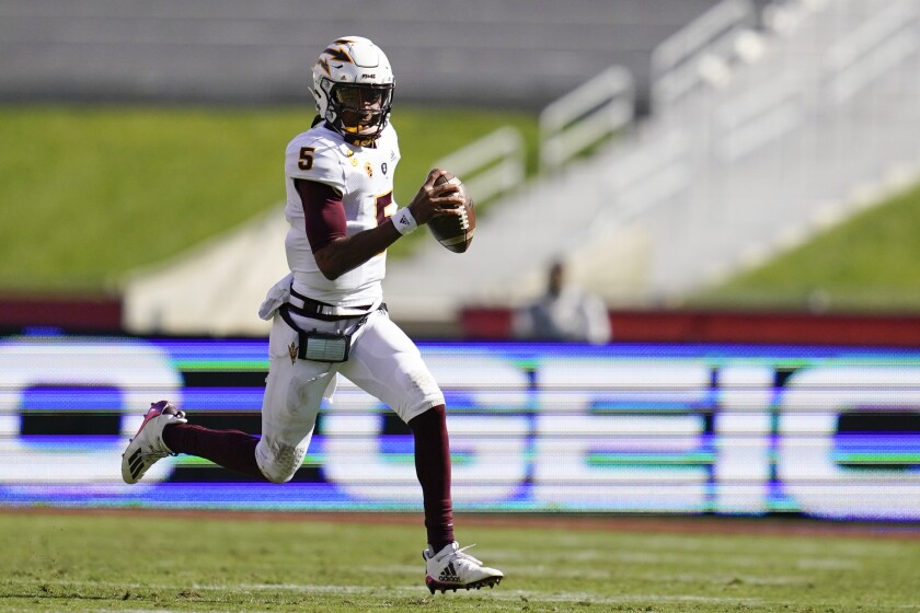 Arizona State quarterback Jayden Daniels runs the ball during the second half against USC.
