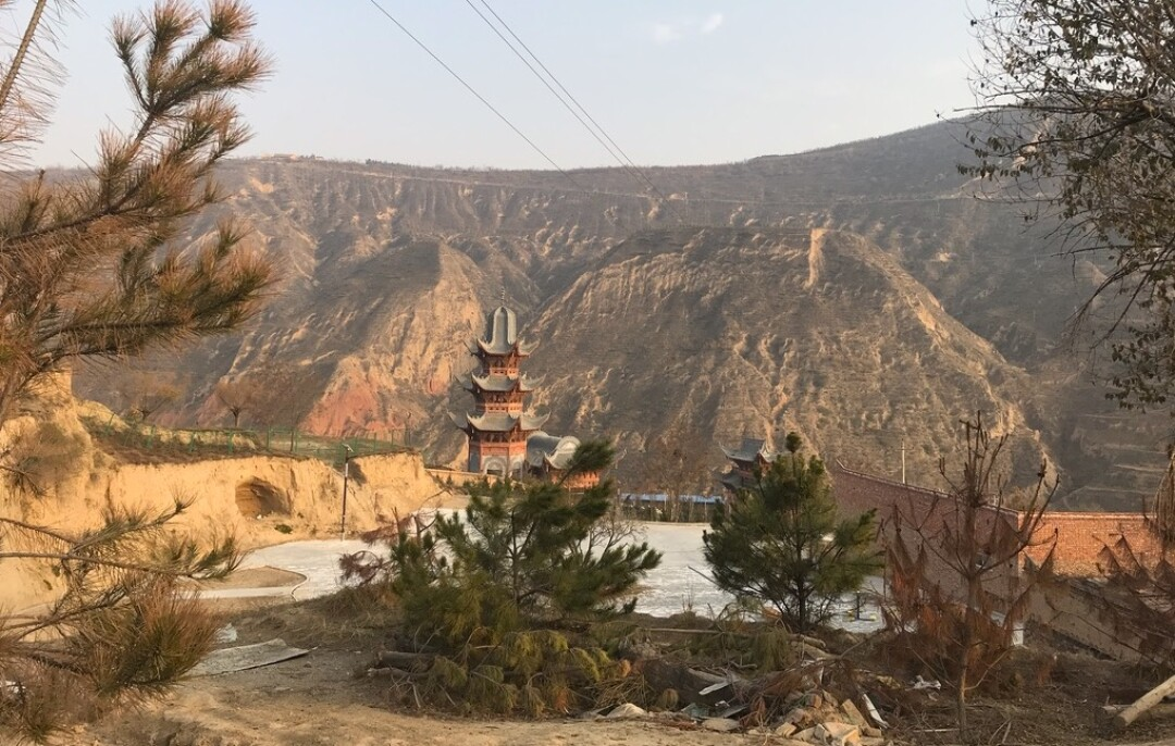 An old Islamic-Chinese tower stands over the Dongxiang minority village of Bulengou.