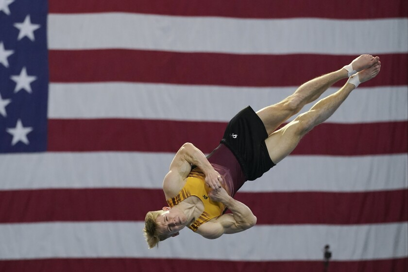 FILE - Shane Wiskus competes during the Winter Cup gymnastics competition in Indianapolis, in this Friday, Feb. 26, 2021, file photo. Three-quarters of the 613-person U.S. Olympic team competed in the American collegiate system. That's the most up-to-date number to illustrate the country's dependence on the NCAA and other college programs to bring home medals. (AP Photo/Darron Cummings, File)