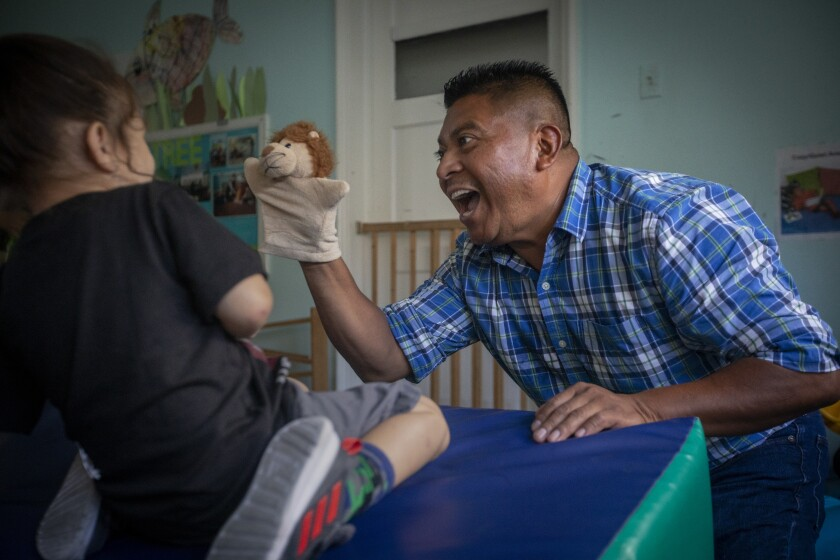 A boy interacts with teacher Ricky Gonzalez at the Atwater Park Center