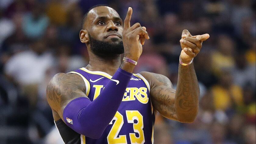 Los Angeles Lakers forward LeBron James (23) celebrates a basket against the Phoenix Suns during the