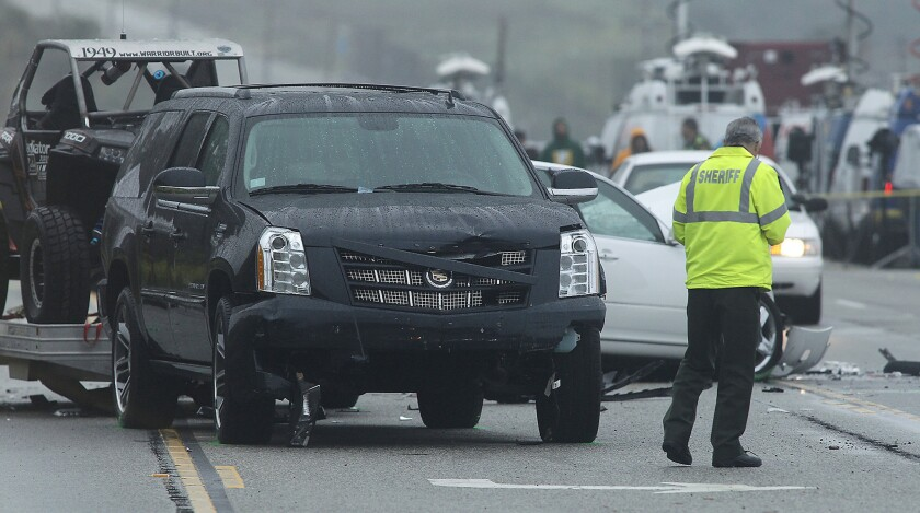 Bruce Jenner was believed to have been driving this black SUV at the time of the collision.