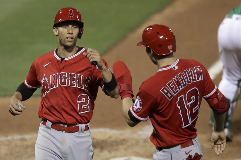 Angels' Andrelton Simmons celebrates with Anthony Bemboom.