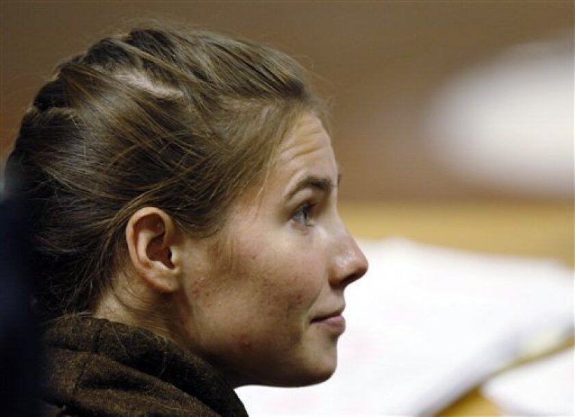U.S. murder suspect Amanda Knox looks on prior to defense hearing by her lawyer Luciano Ghirga, not pictured, at the court in Perugia, Italy, Wednesday, Dec. 2, 2009. Defense lawyers have begun their closing arguments, seeking to show that evidence in the case isn't sufficient to convict her. Amanda Knox and her former boyfriend Raffaele Sollecito are being tried in Perugia for the 2007 slaying of Meredith Kercher. They deny wrongdoing. (AP Photo/Luca Bruno)
