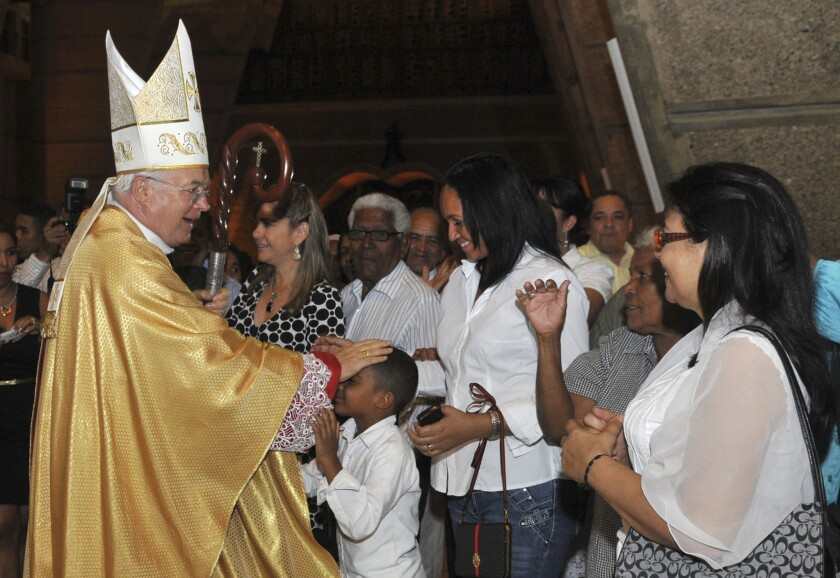 Archbishop Jozef Wesolowski greets people after a Mass in Santo Domingo, Dominican Republic, in March 2013.