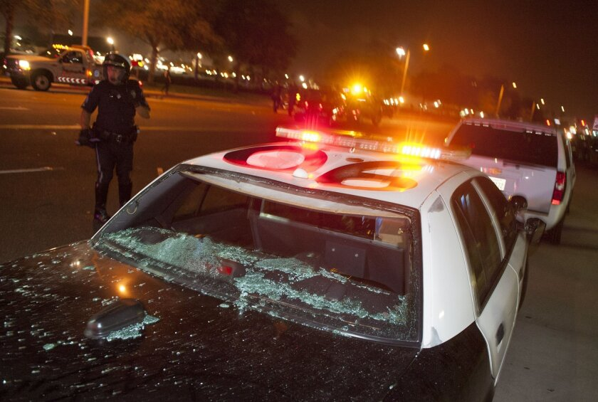 A damaged Costa Mesa Police cruiser sits at the corner of Fair Dr. and Fairview Rd. near the OC Fairgrounds where Donald Trump spoke earlier  in Costa Mesa.