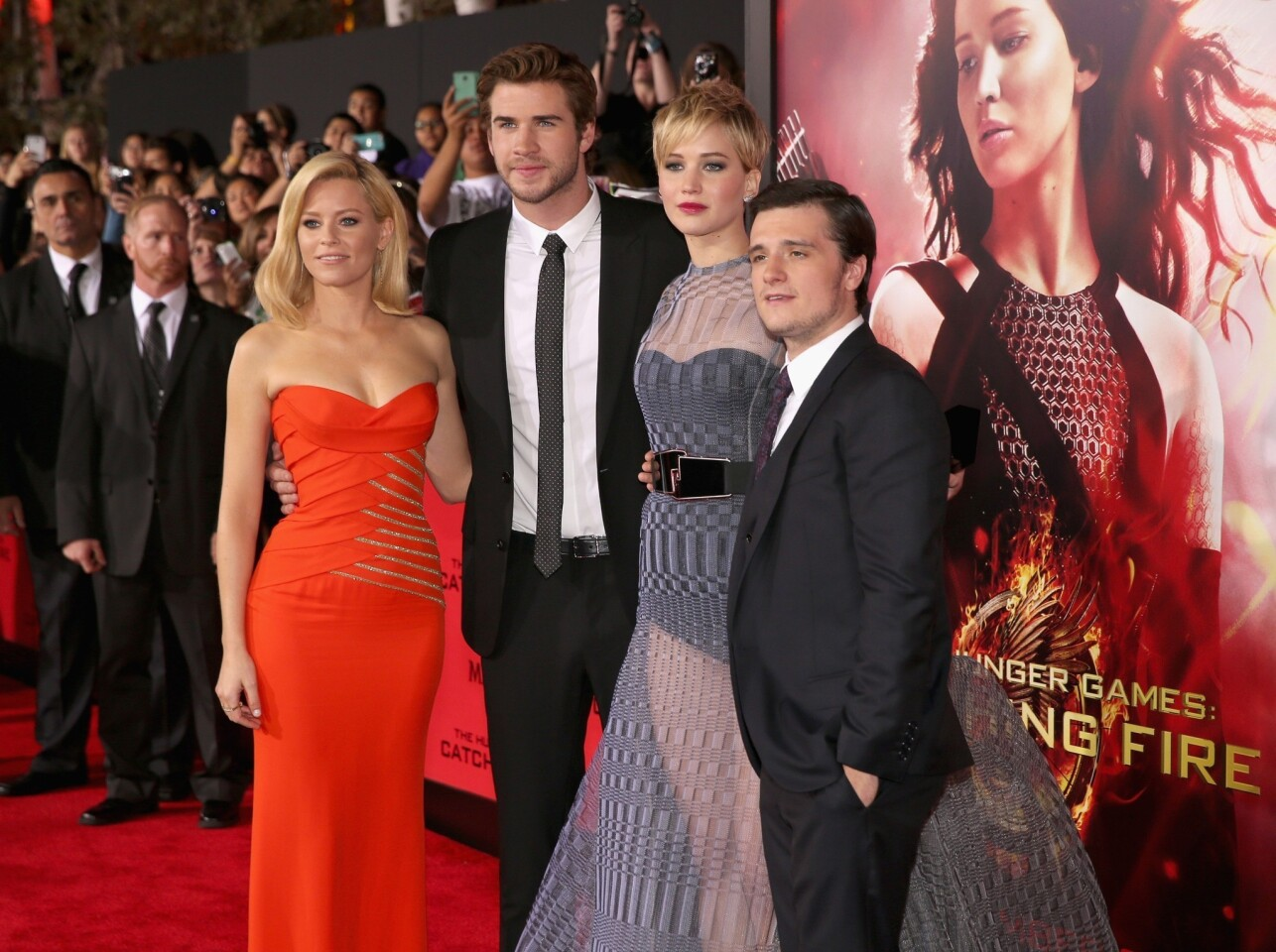 "Cast members, from left, Elizabeth Banks, Liam Hemsworth, Jennifer Lawrence and Josh Hutcherson attend the premiere of Lionsgate's ""The Hunger Games: Catching Fire"" at the Nokia Theatre in Los Angeles."