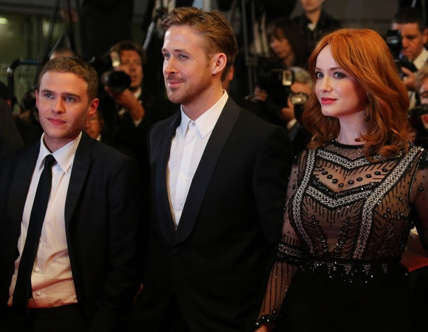 """Actors Iain De Caestecker, left, Ryan Gosling and Christina Hendricks arrive on May 20 for the screening of """"Lost River"""" in Cannes."""