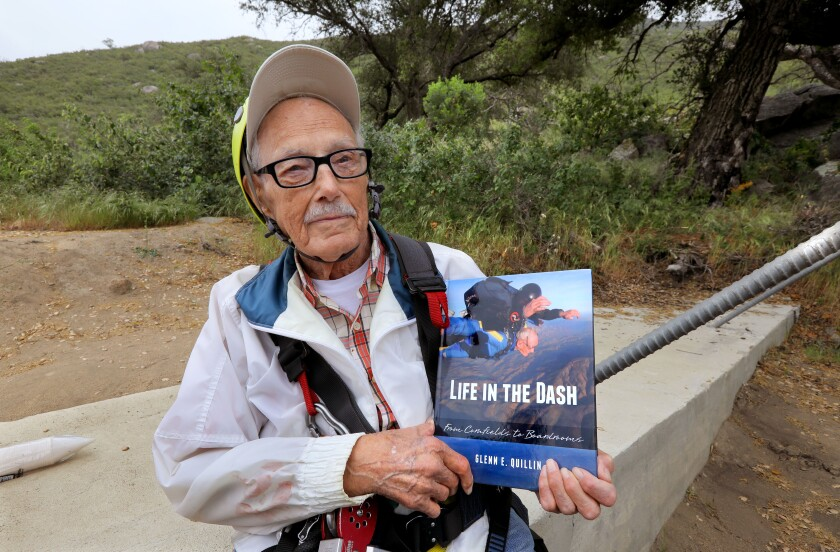 Glenn Quillin, 102, holds a copy of his memoir featuring a photo of him skydiving on its cover. Before the photo was taken in May 2018, he did three zip lines rides at La Jolla Zip Zoom on the La Jolla Indian Reservation.