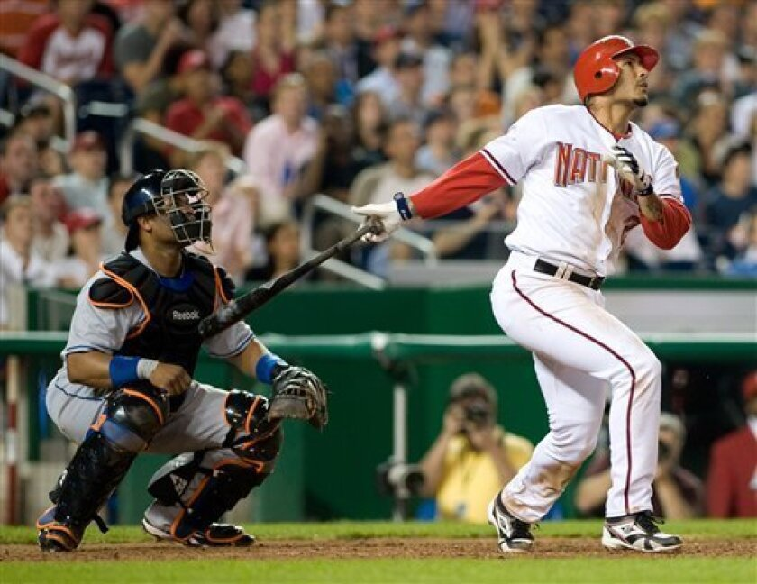 During the sixth inning an MLB game, Washington Nationals' Felipe Lopez, right, hits a two-out grand slam against the New York Mets on Thursday, April 24, 2008, in Washington, D.C. (AP Photo/Chad J. McNeeley)