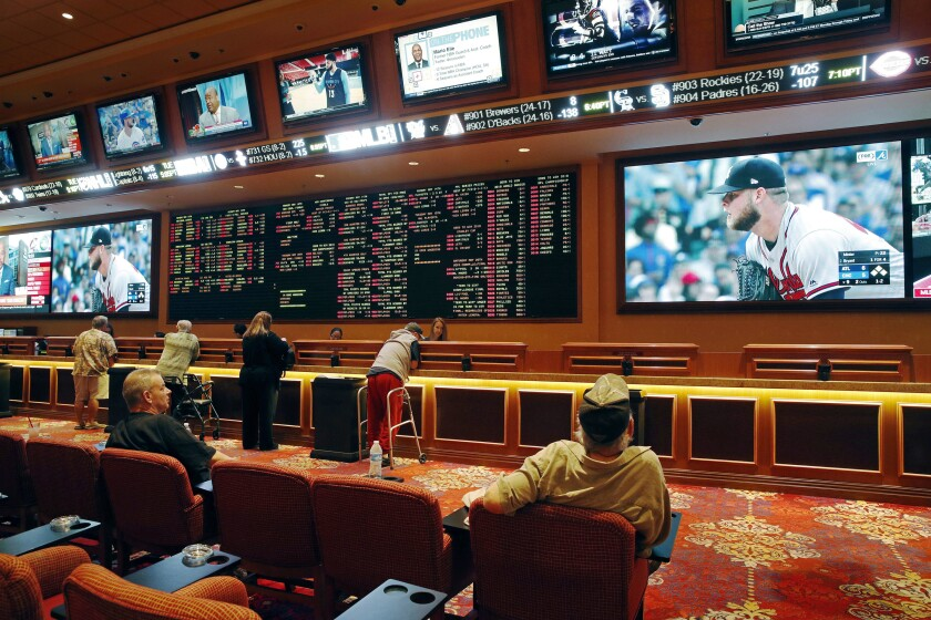 People make bets in the sportsbook at the South Point Hotel Casino and Spa in Las Vegas in 2018.