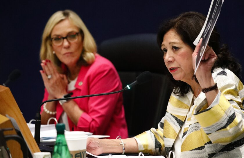 Los Angeles County Supervisors Hilda Solis, right, and Kathryn Barger during a 2019 board meeting.