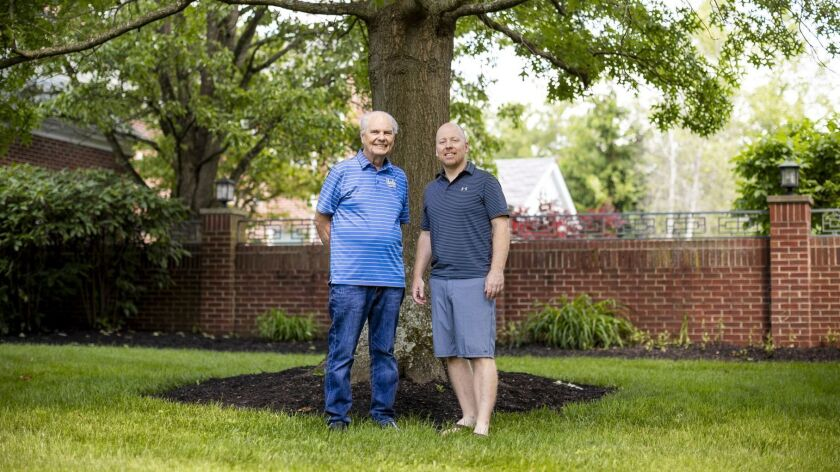 Hep Cronin, left, stands with his son, UCLA basketball coach Mick Cronin at Mick's home In Cincinnat