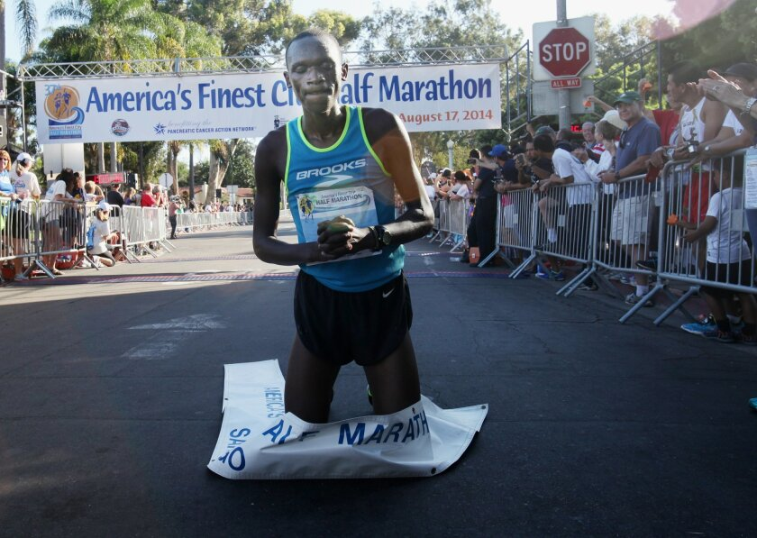 At the finish of Sunday's AFC Half Marathon, race winner Nelson Oyugi, finishing with a time of 1:05:17, knelt for a prayer.  The  37th annual America's Finest City Half Marathon coursed through San Diego Sunday morning, beginning at the Cabrillo National Monument, down Harbor Blvd, up A street