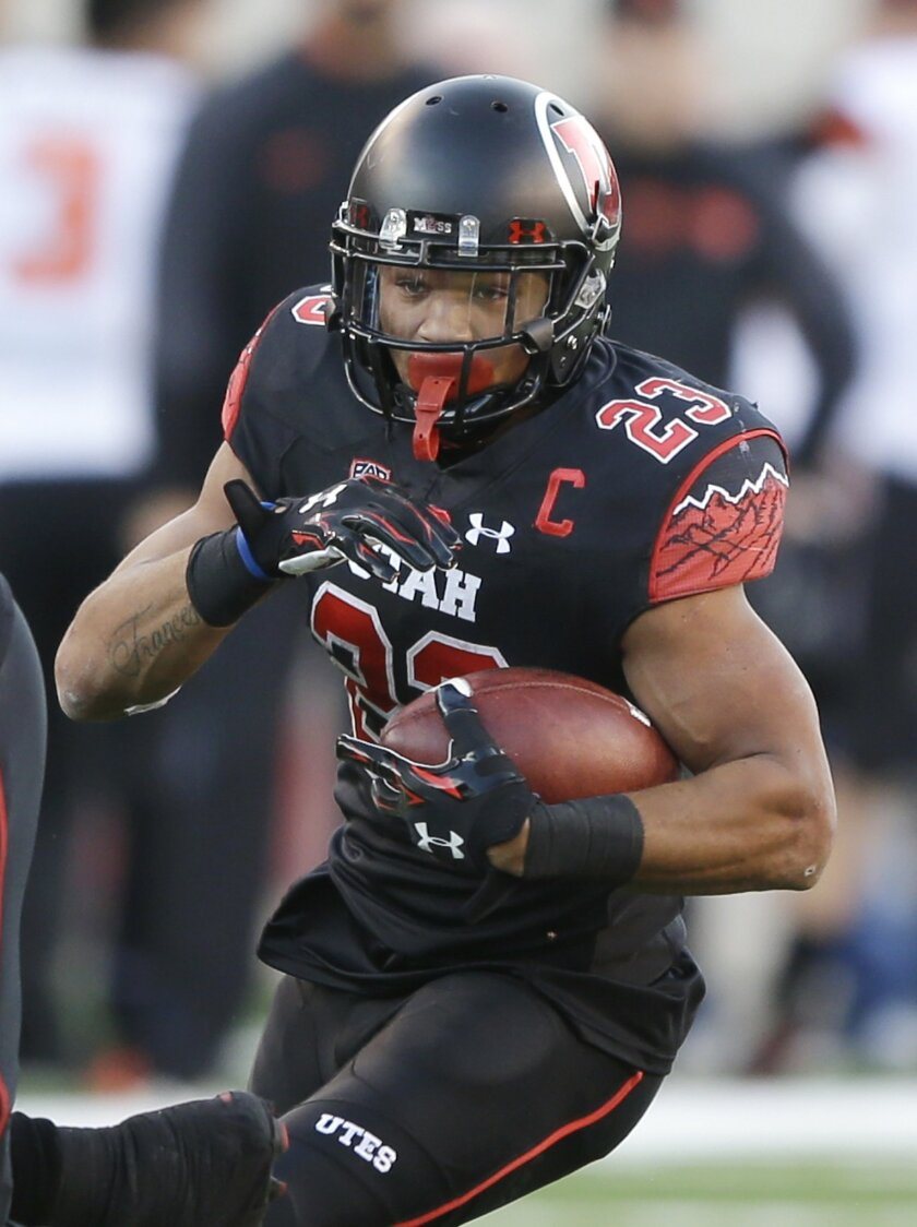 Utah running back Devontae Booker (23) carries the ball in the first quarter during an NCAA college football game against Oregon State, Saturday, Oct. 31, 2015, in Salt Lake City. (AP Photo/Rick Bowmer)