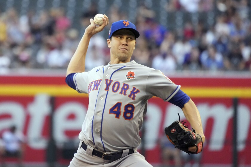 New York Mets pitcher Jacob deGrom throws against the Arizona Diamondbacks in the first inning during a baseball game, Monday, May 31, 2021, in Phoenix. (AP Photo/Rick Scuteri)