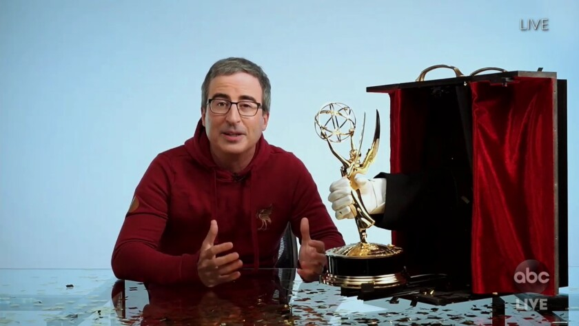 John Oliver with his Emmy.