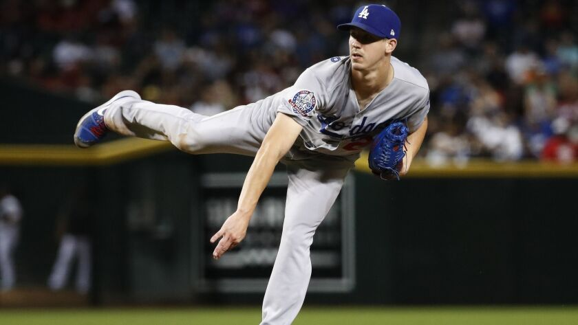 Los Angeles Dodgers starting pitcher Walker Buehler throws to an Arizona Diamondbacks batter during