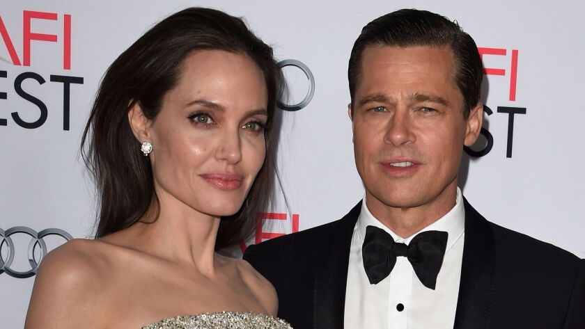 "Angelina Jolie and Brad Pitt appear at the ""By the Sea"" premiere in November 2015."