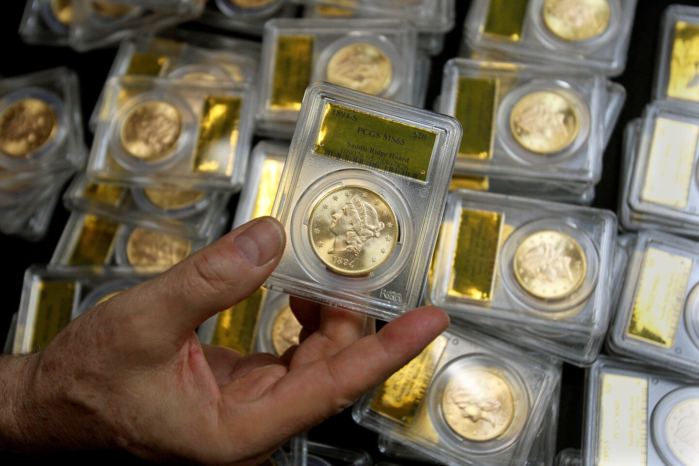 Some of 1,427 Gold Rush-era U.S. gold coins found buried in the Salinas Valley are displayed at Professional Coin Grading Service in Santa Ana.